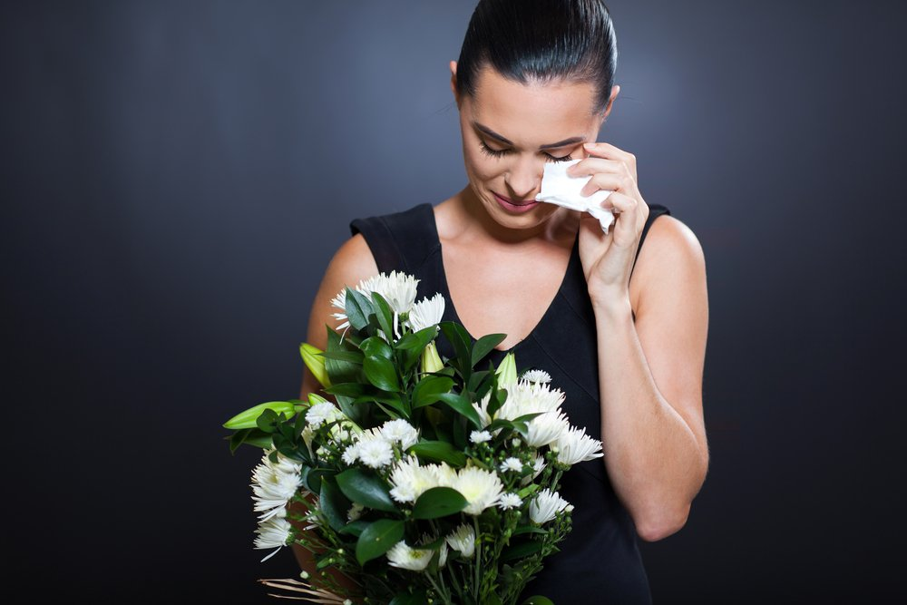 woman crying in dress