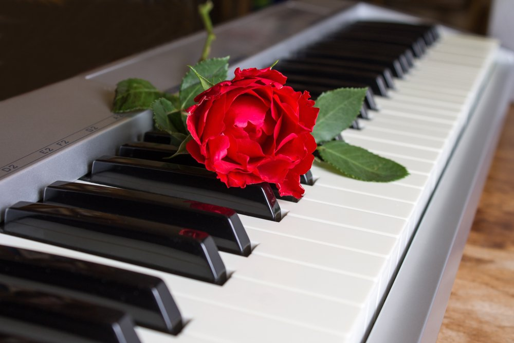 Rose on Piano that will provide music for funeral