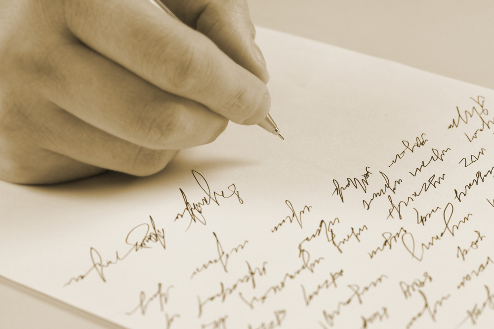 Woman writing condolence letter