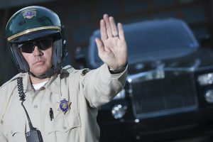Police officer with hand up to stop