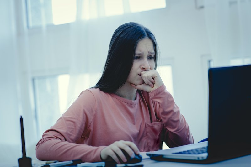 Upset woman sitting at a computer